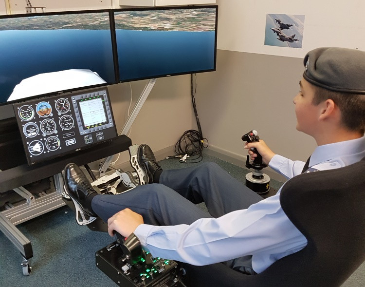 A young cadet flies the new simulator