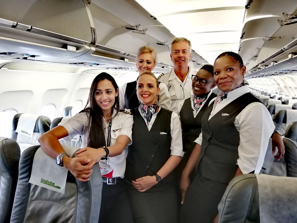 Sheetal on the left, with Global Airways crews