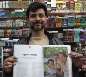 "Brooklyn Deli owner holding open Brownbook magazine to my ""sippin' Sharbat"" article - photo by Azita Houshiar"