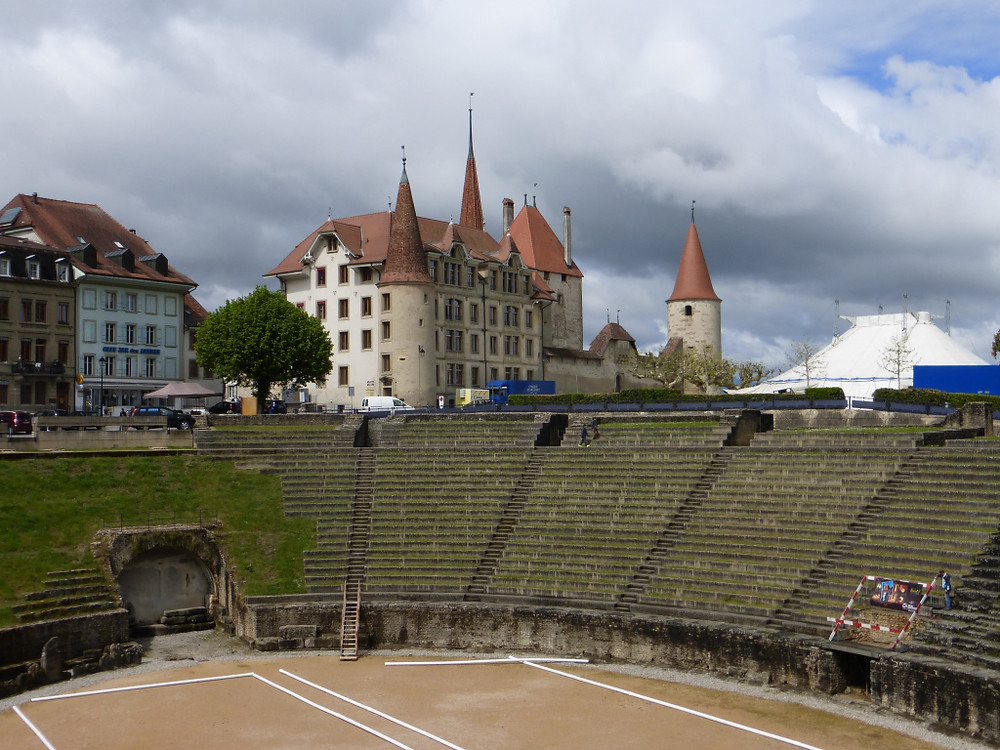 Roman amphitheater at Avenches with medieval (?) castle behind