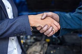 mechanic-shaking-hands.jpg