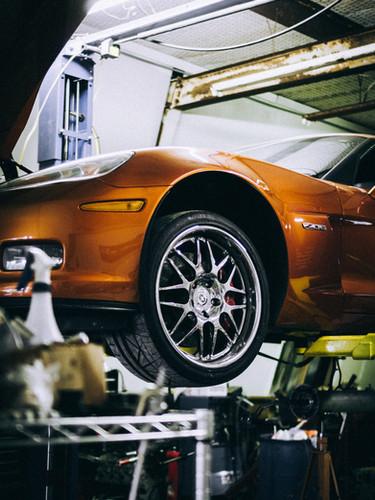 new-copper-car-on-lift-zell-unsplash.jpg