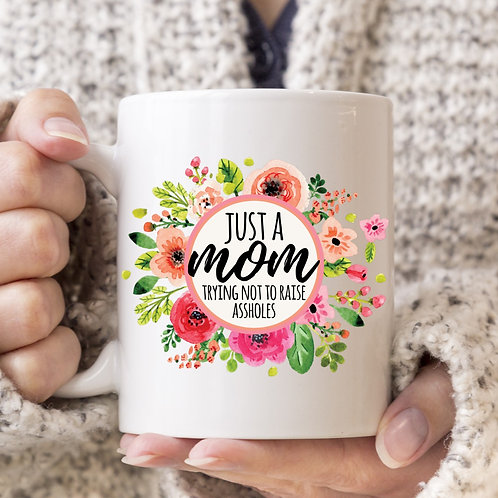 just a mom trying not to raise assholes mug