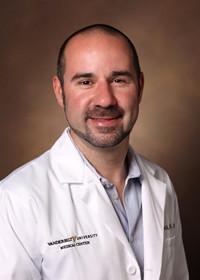Dr. Justin Balko