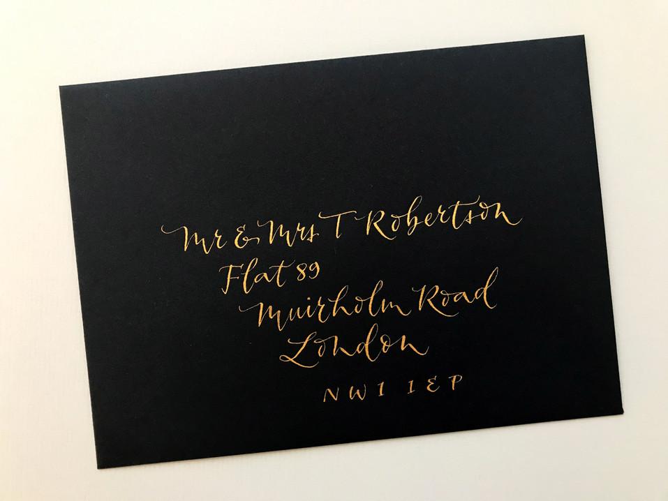 Gold ink on black envelope