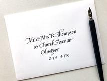 Black ink on white envelope