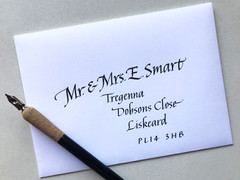White envelope addressed with black ink