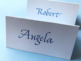Blue ink on white place cards