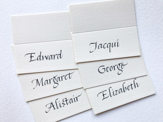 Black ink on white place cards