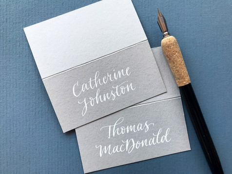 White ink on light grey place card