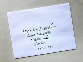 Green ink on white envelope