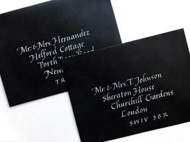 White ink on black envelopes