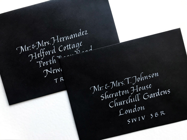 White ink on black envelopes