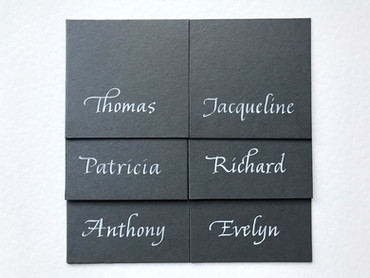 White ink on dark grey place cards