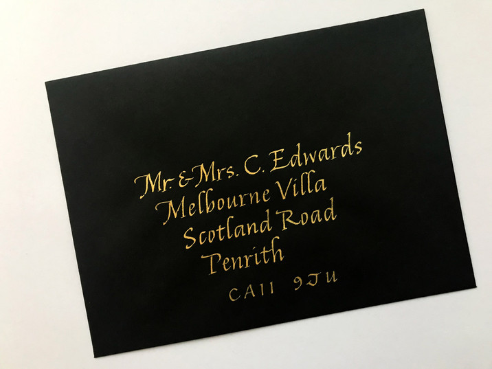 Gold ink on black envelope