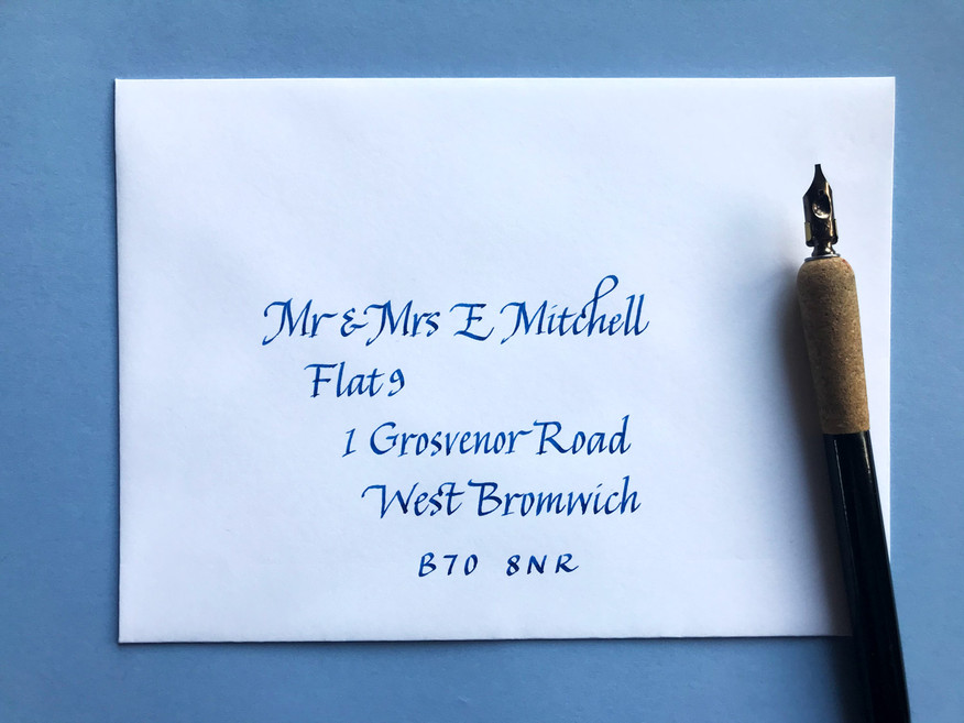 Blue ink on white envelope