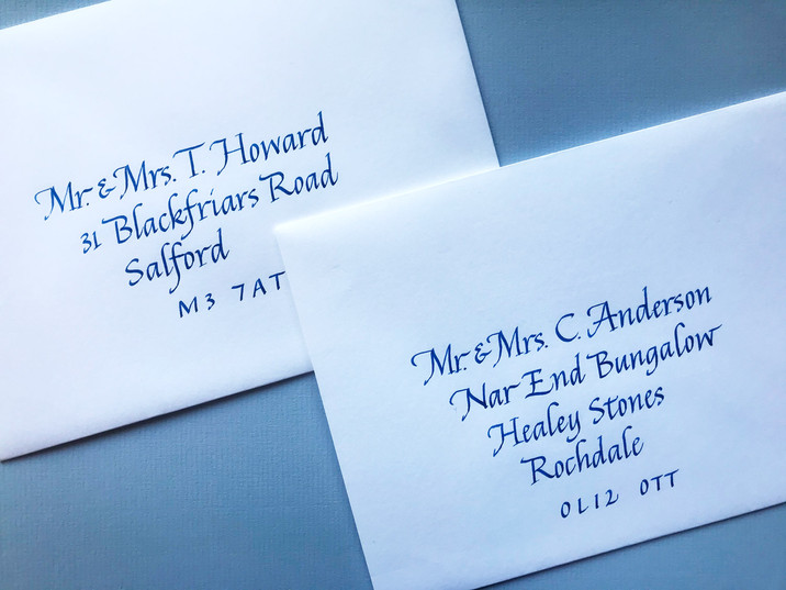 Blue ink on white envelopes