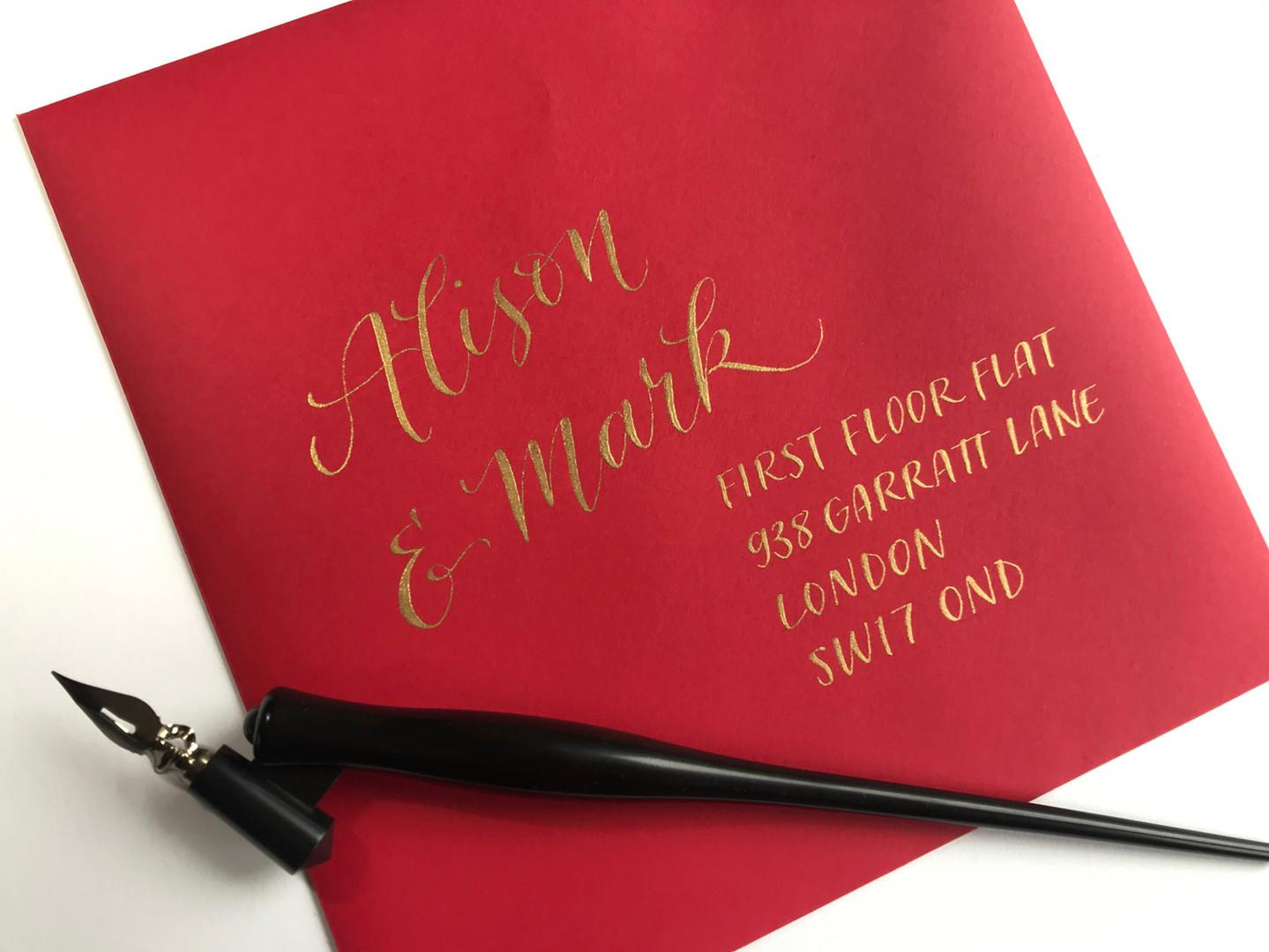 Gold ink on red envelope