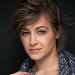 Headshot of Dóra Horváth, Head of Retail Credit Product & Process Management at K&H Bank.