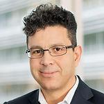 Headshot of Elmo Ninier, Chief Digital Officer at QCENTRIS.