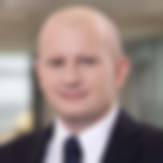 This is a headshot of Szymon Szczypiński, Head of Communication and Product Management Department at Bank BPH.