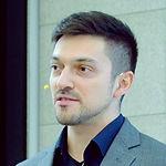 Headshot of Cristian Chiru, User Experience Designer at BCR.