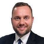 Headshot of Adam Malinowski, VP Sales & Marketing at SIGNAL IDUNA Polska.