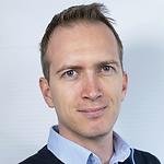 This is a headshot of László Személyi, Surf Studio Program Manager at K&H Bank.
