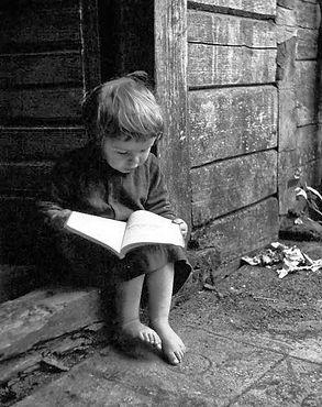 poor boy and book.jpg