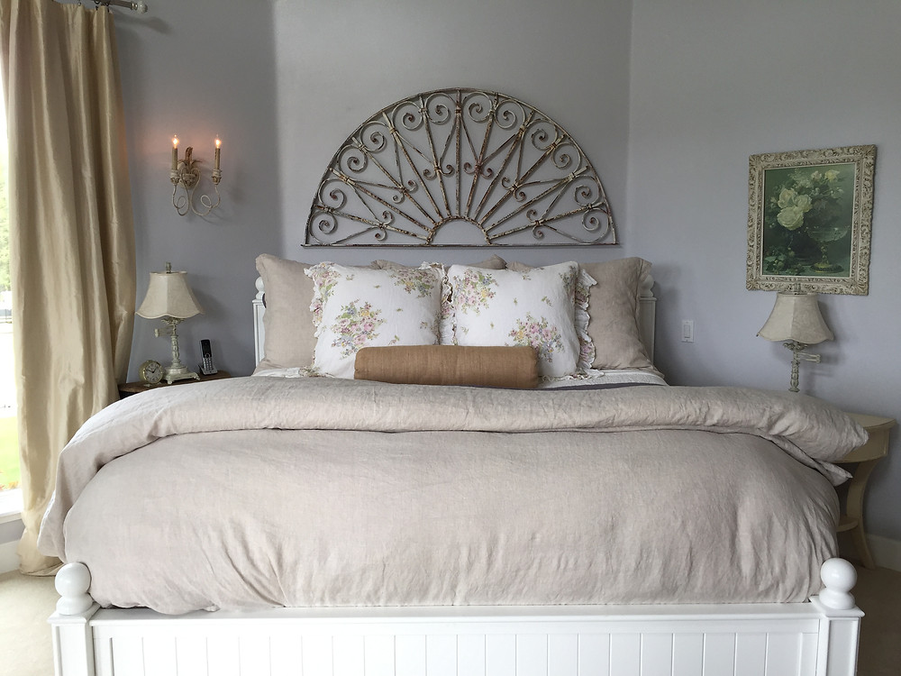 Antique architectural salvage iron peice above the bed.