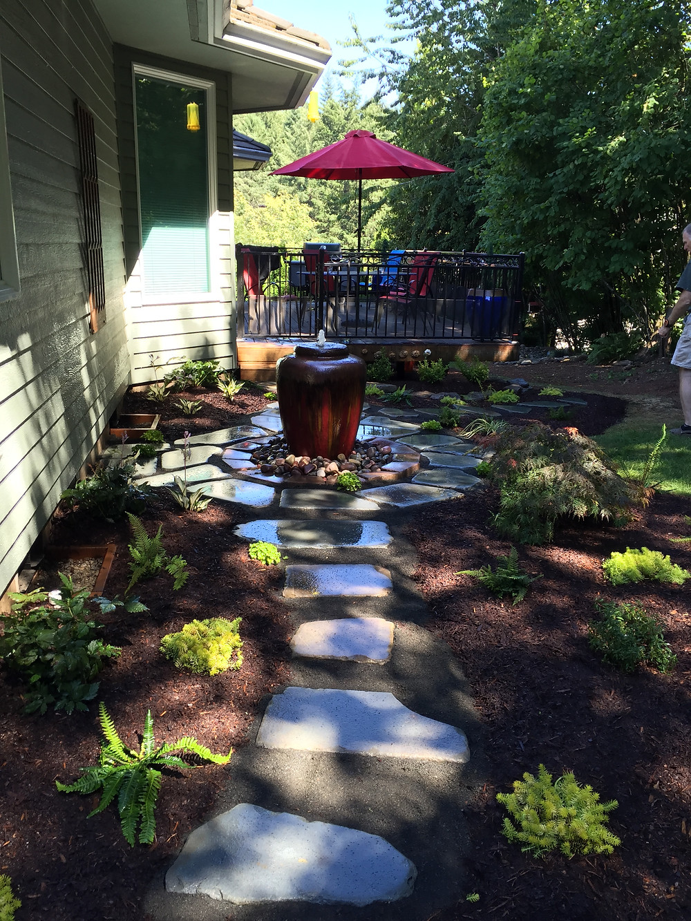 Blue stone path around water feature to patio.