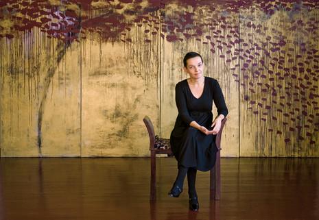 Marita Liulia with the painting Autumn, 2008