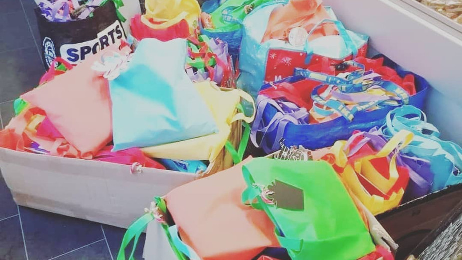 Working with local businesses to make Christmas Bags for the food bank.