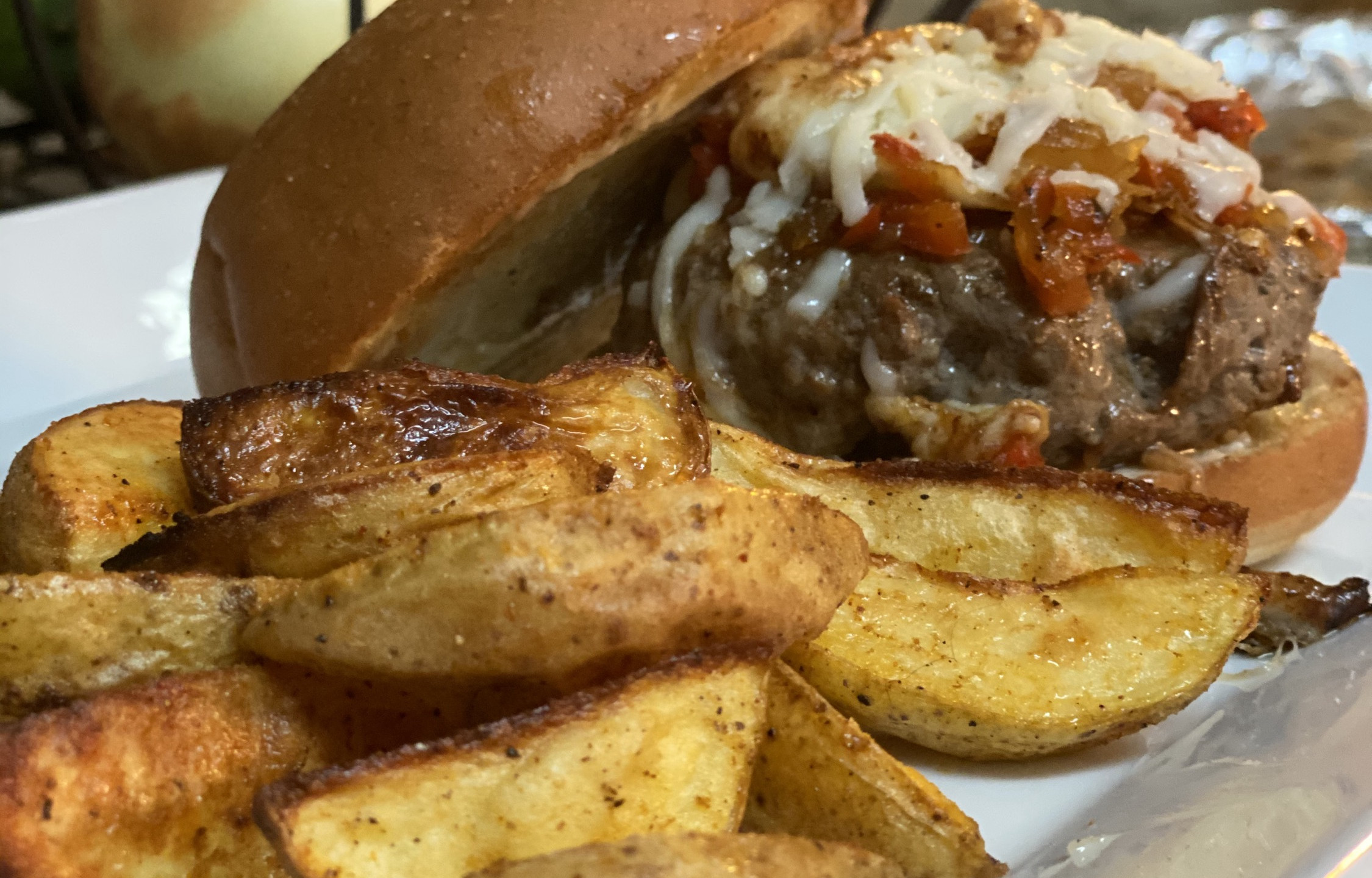 Mangia mozzarella burger with pepper relish, garlic aioli and potato wedges