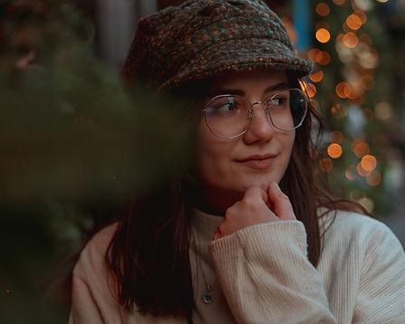 Portrait of girl with glasses on Victoria Street Edinburgh
