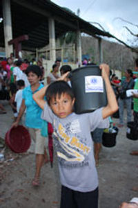 Young man carrying disaster relief supplies