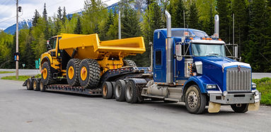 Big truck with a low platform trailer ca