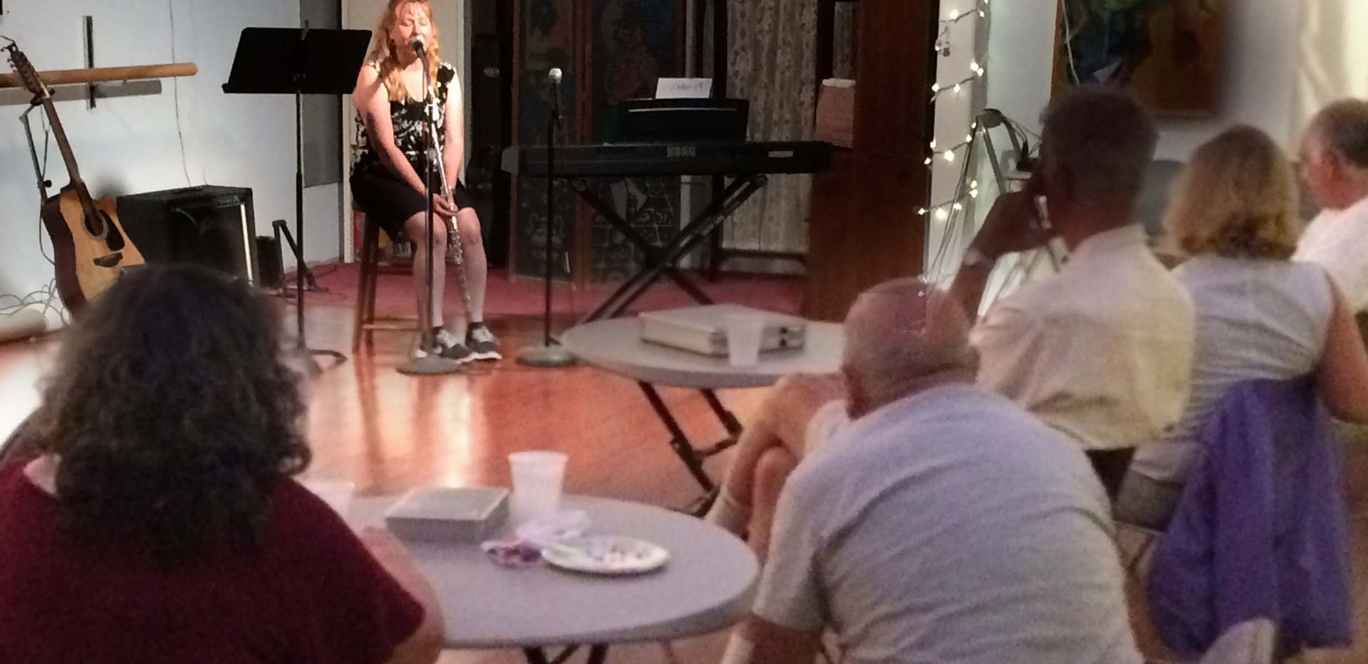 Julie doing storytelling at Open Mic night