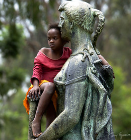 Girl with statue, Angola