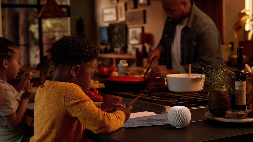 A Family mealtime with a White HomePod mini on the table