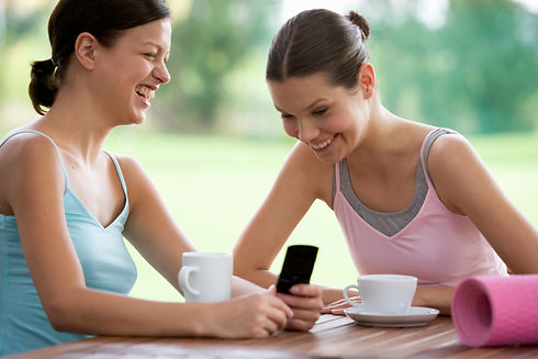 Two young women drinking coffee after a