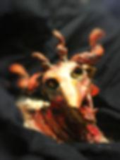 demon beast horned sculpture