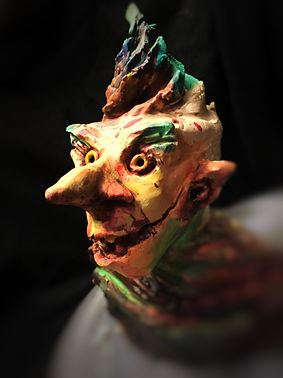gnome elf sculpture creepy sculpture