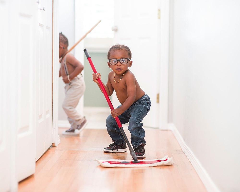 Kids having fun helping clean the floors.