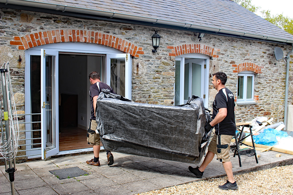 Adrian and Phil using waterproof sofa carry bags