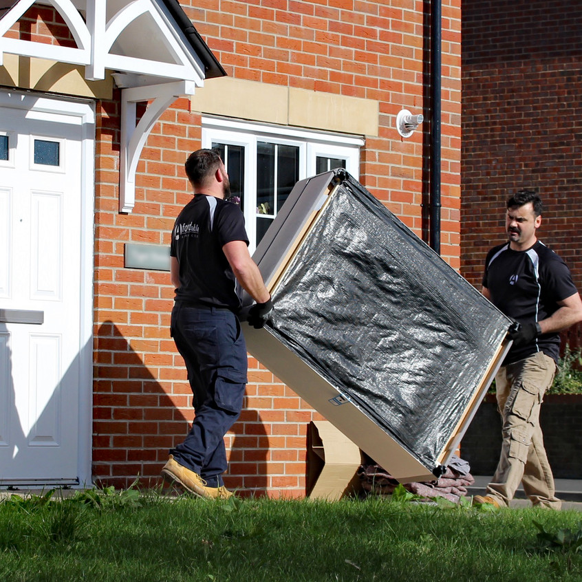 Adrian and Phil moving a sofa