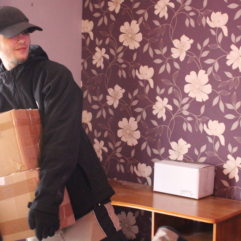Leon Ford moving some boxes