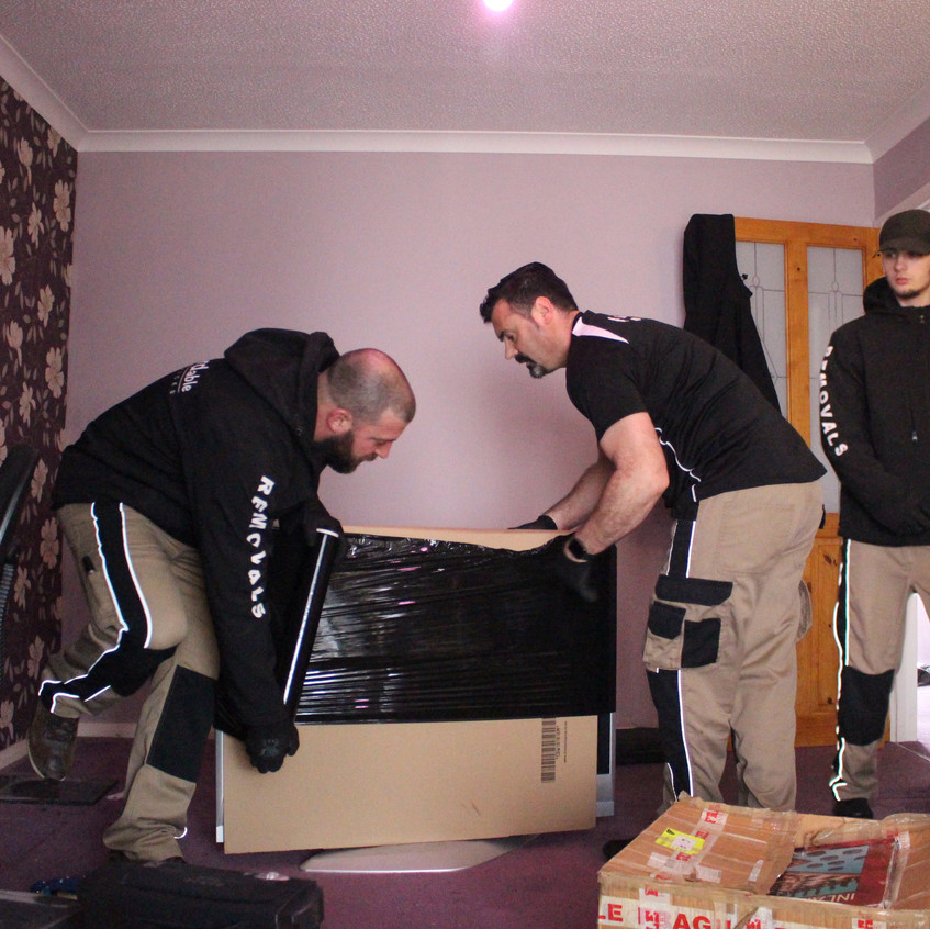 The team packing up the Television