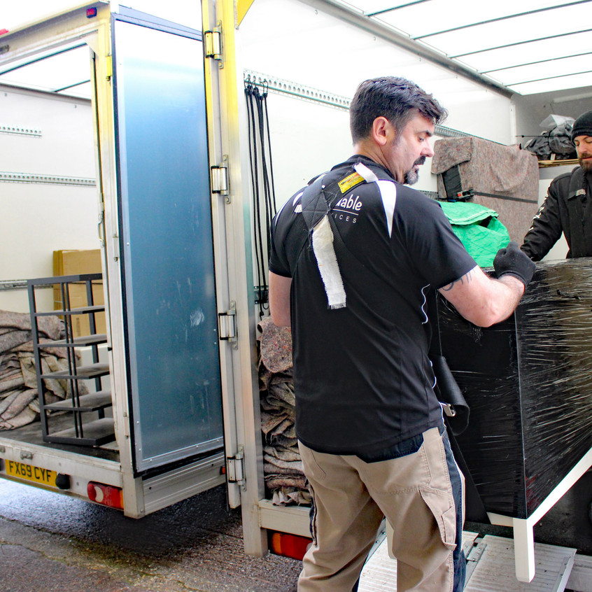 Phil and Aidi unloading the vehicles
