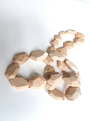 Hand carved faceted wood bead necklace on red silk